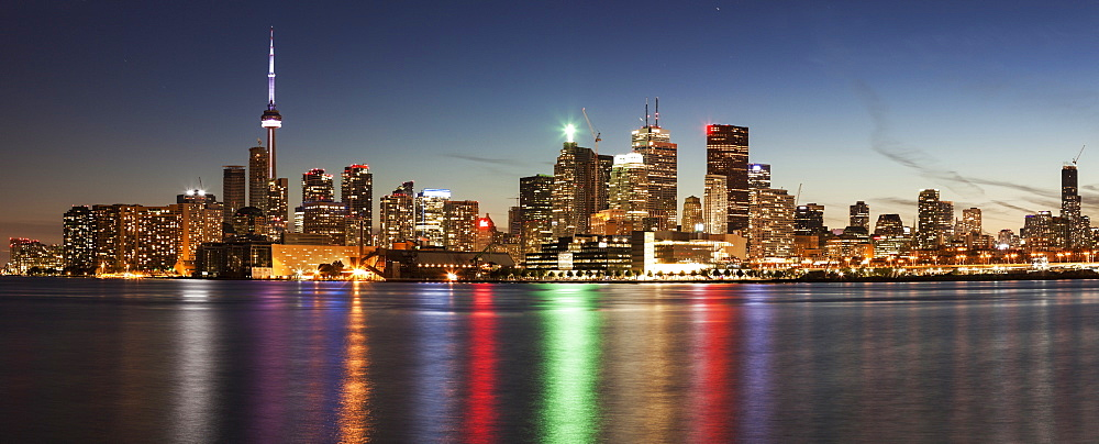 Illuminated waterfront skyline reflecting in Lake Ontario, Toronto, Canada