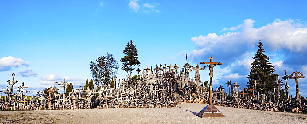 Hill of crosses under cloudy sky, Lithuania