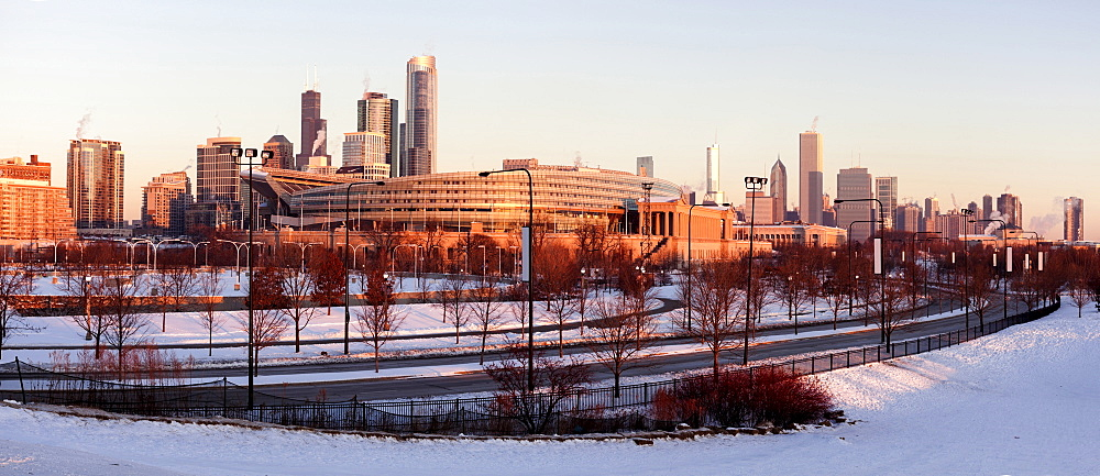 Soldier Field and city skyline at sunrise, Chicago, Illinois