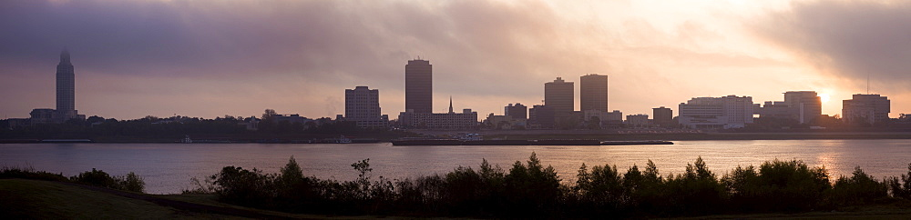 USA, Louisiana, Baton Rouge, City skyline over Mississippi River at sunrise