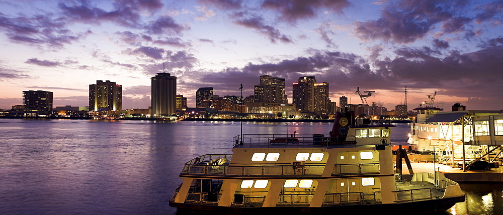 USA, Louisiana, New Orleans, Ferry on Mississippi River with city skyline