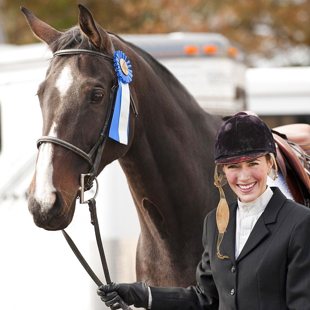 Horse wearing ribbon