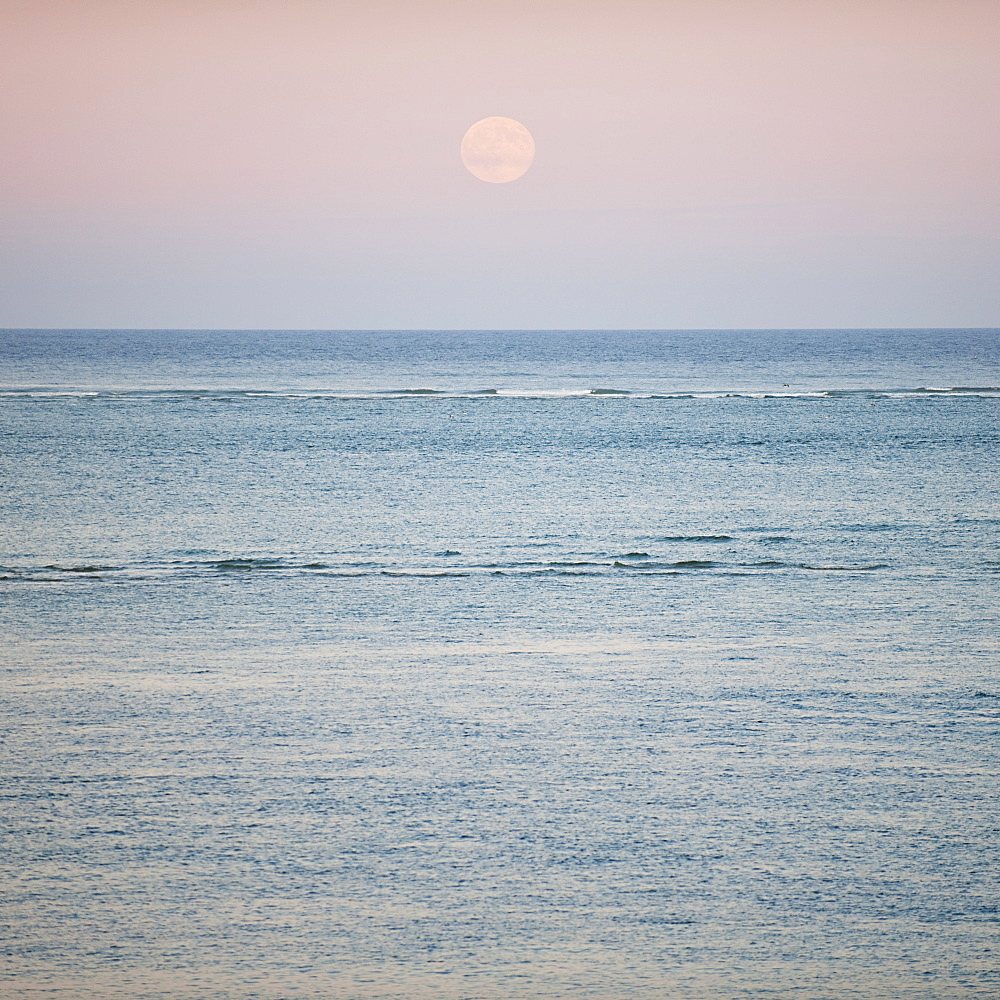 Moonrise over ocean