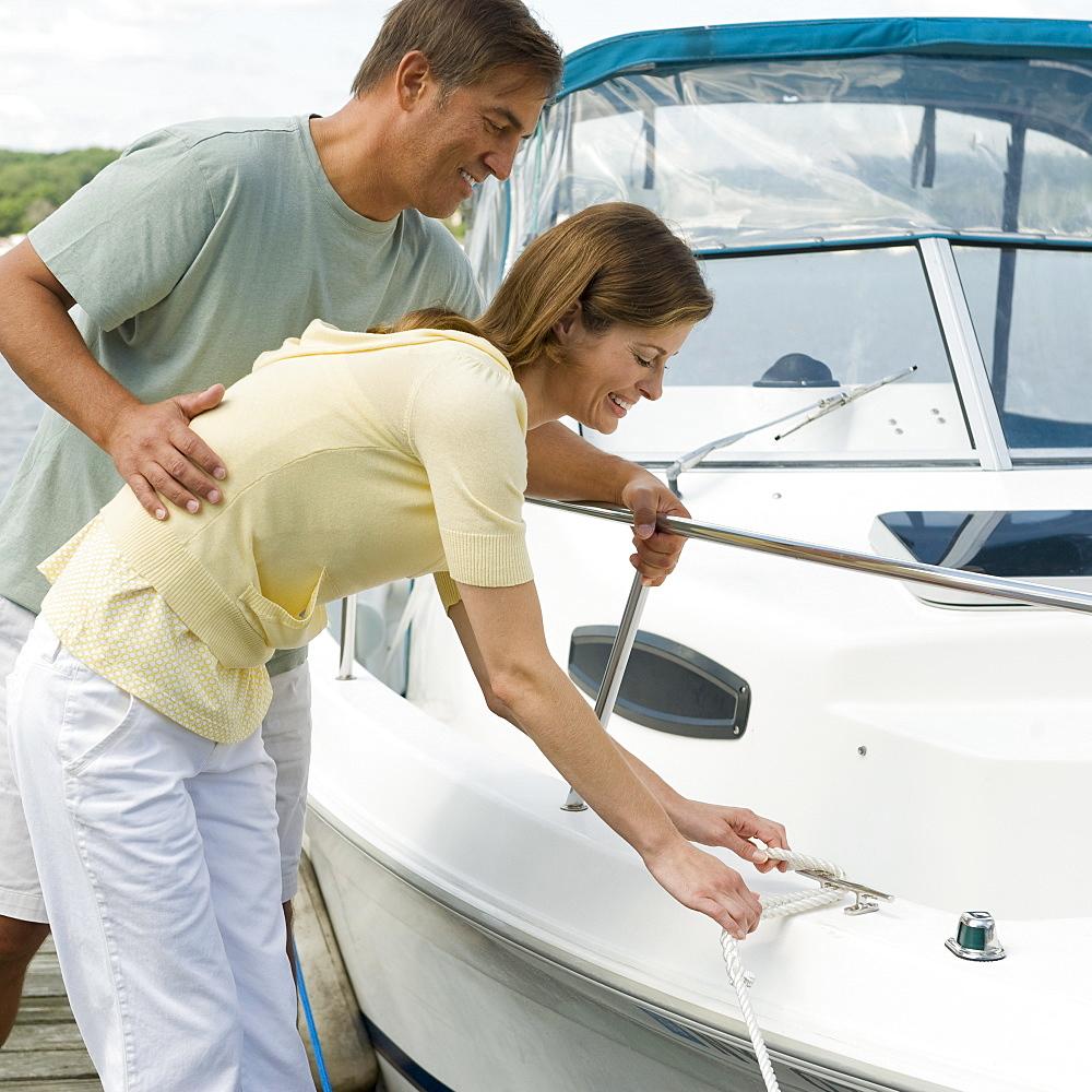Couple docking speed boat
