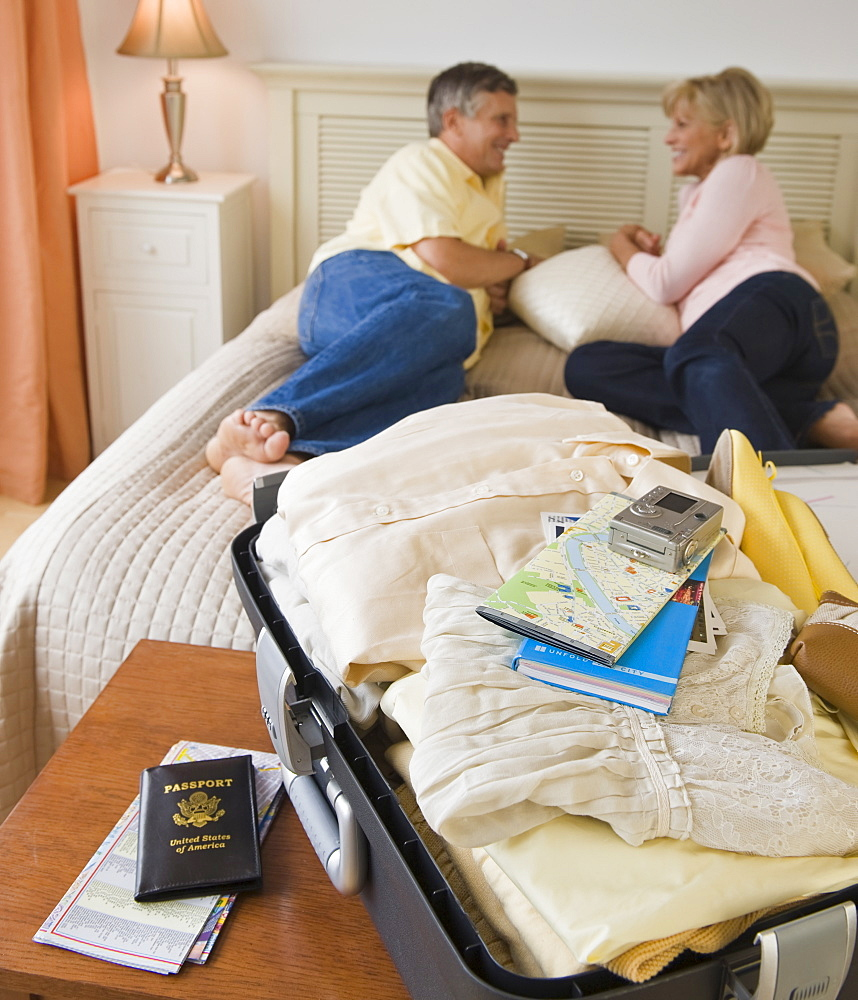 Couple resting on hotel bed