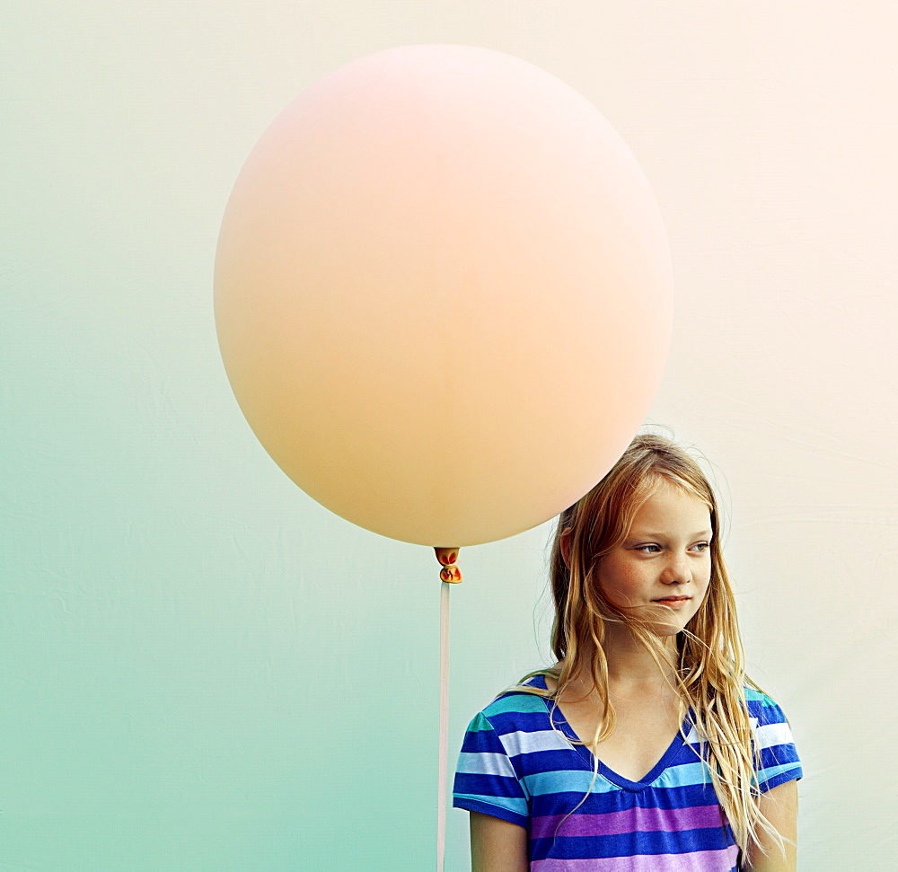 Texas, Austin, Blonde girl holding big balloon
