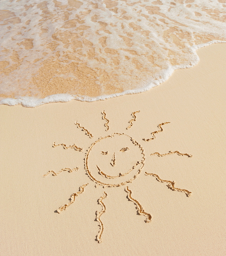 Sun drawing on beach