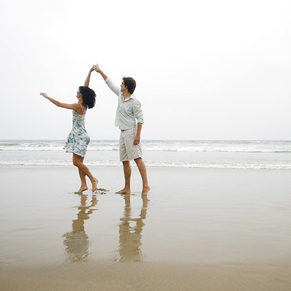 Couple dancing on beach