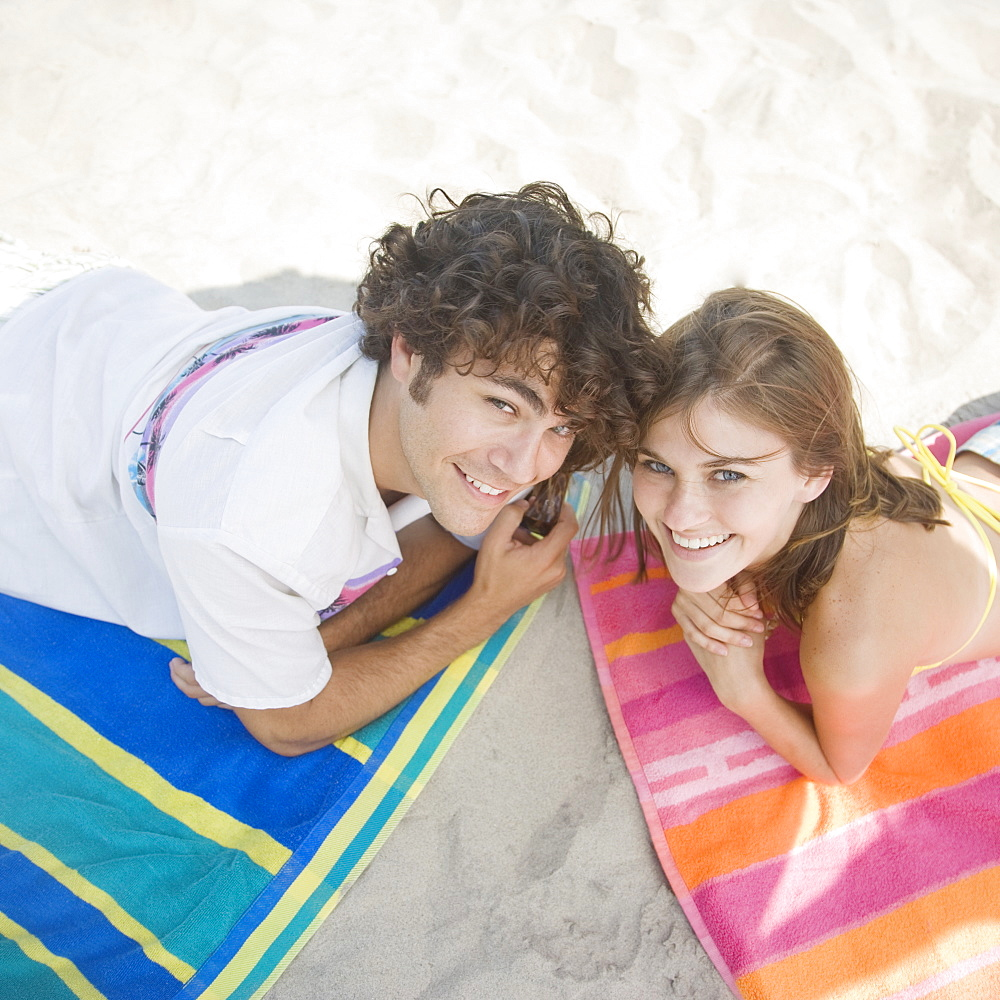 Couple laying on beach towels