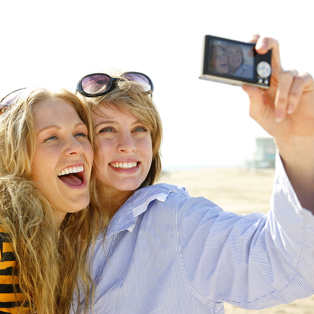 Two young women taking self-portrait