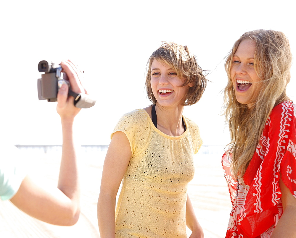 Women being filmed on beach