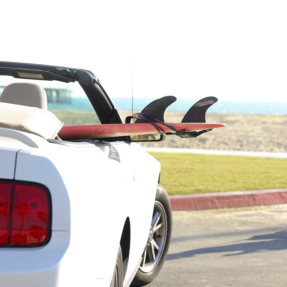 Surfboard in convertible car