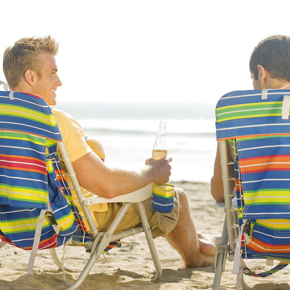 Two men sitting in beach chairs