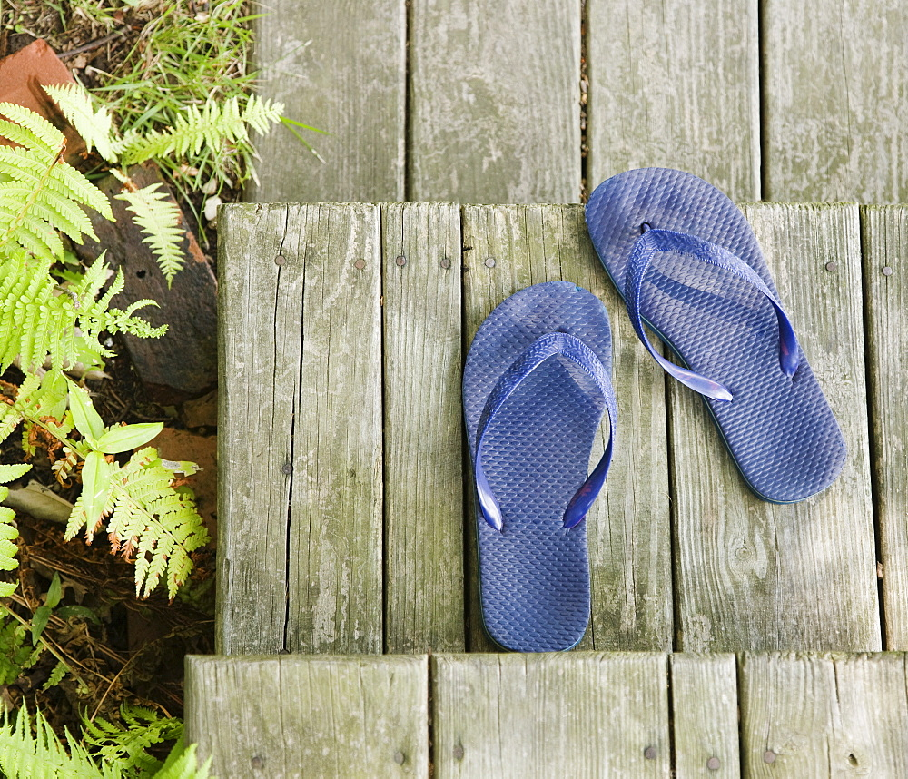 Flip-flops on wooden deck