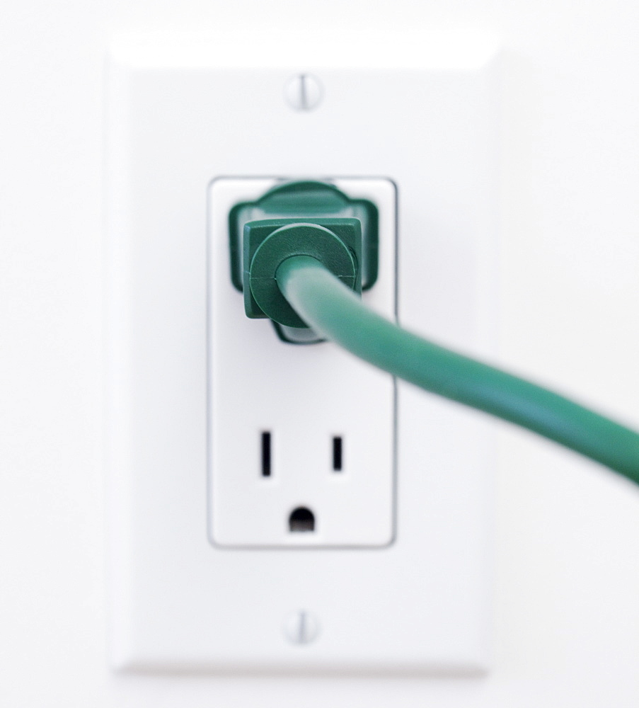 Close up of electric plug and wall outlet
