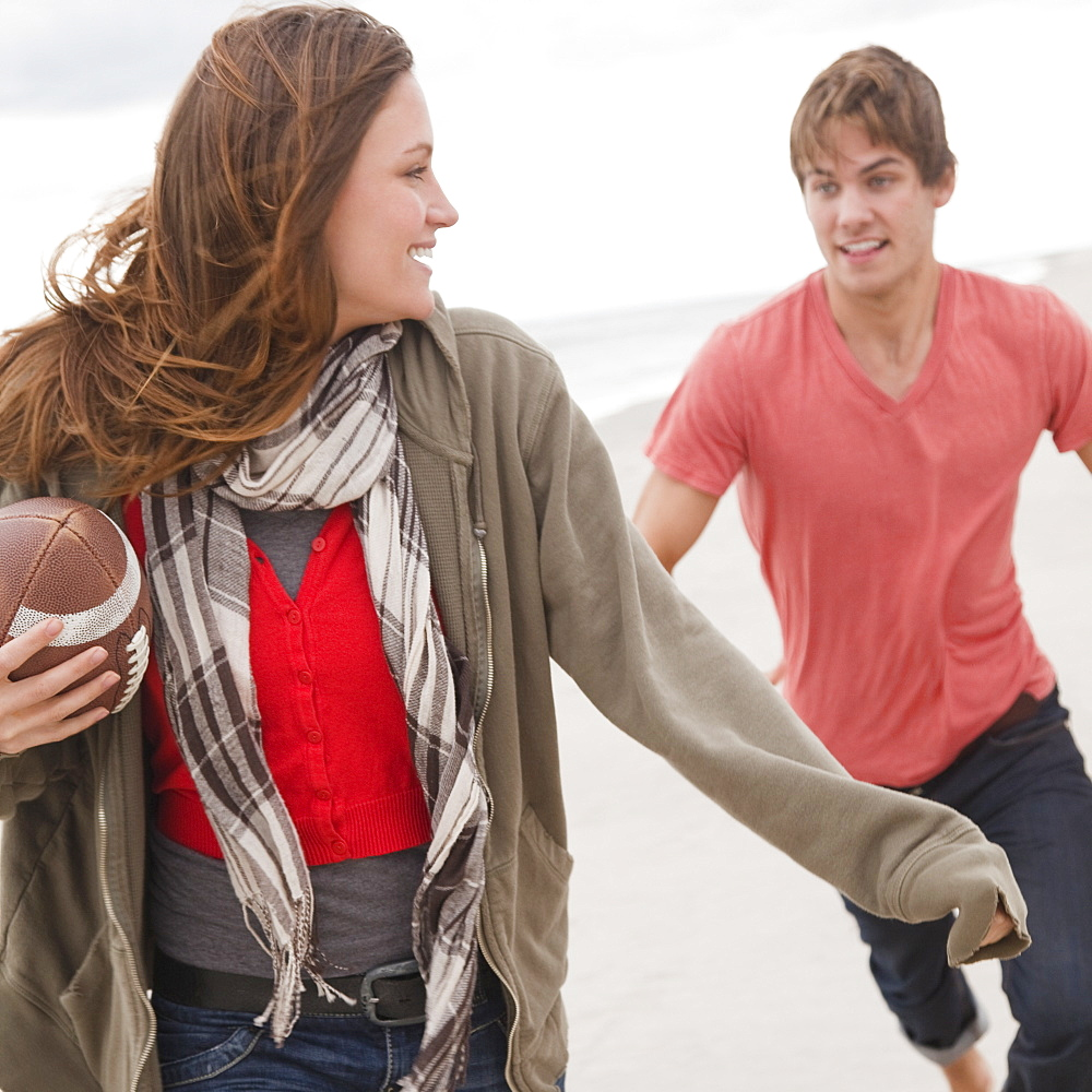 Couple playing football