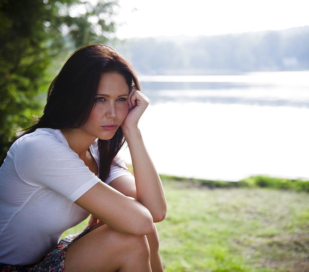 Roaring Brook Lake, Lonely woman sitting by lake