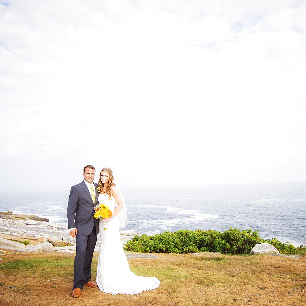 Portrait of married couple, sea in background, USA, Maine, Bristol