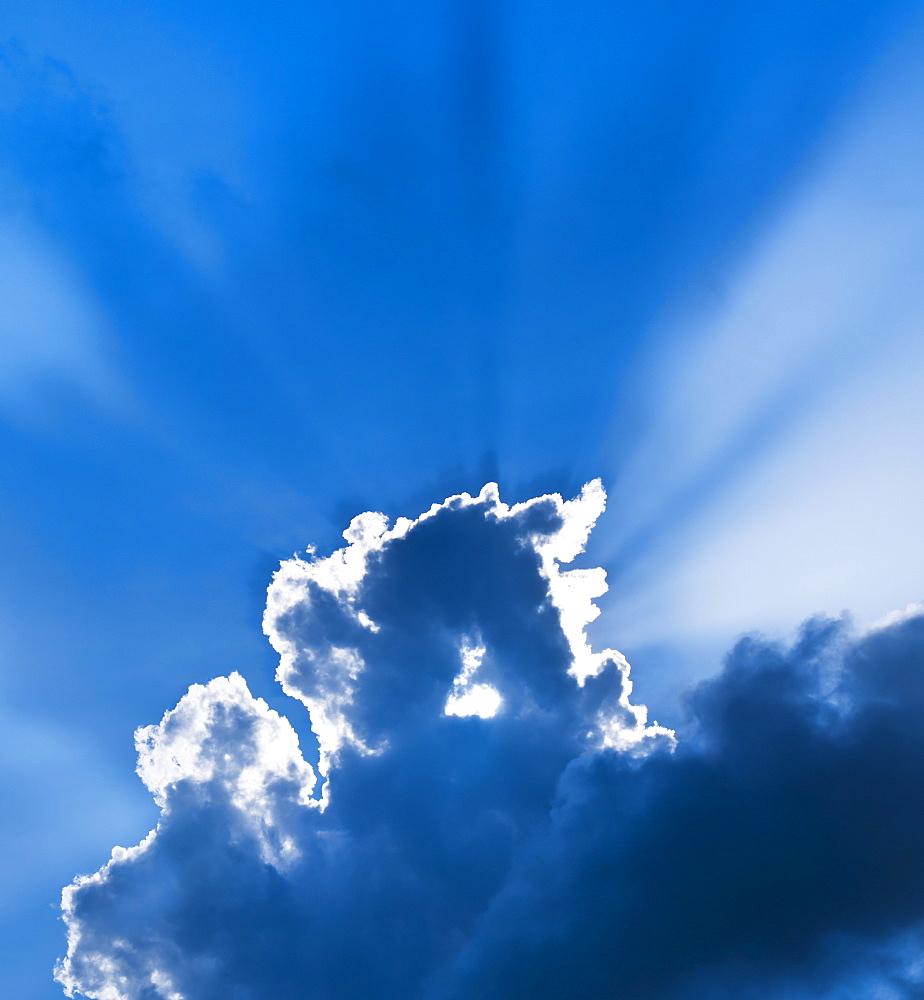 Sunbeams breaking through clouds