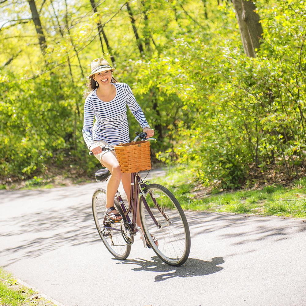 Mid adult woman riding bicycle, Central Park, New York City
