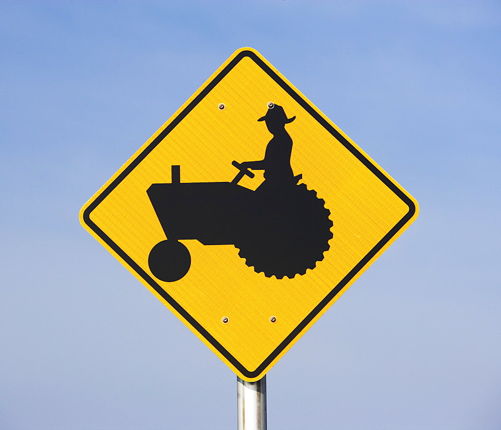farmer on tractor sign
