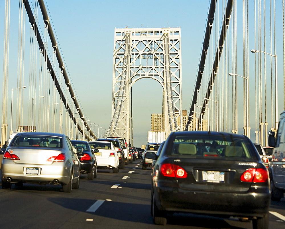 Cars moving across George Washington Bridge, New York