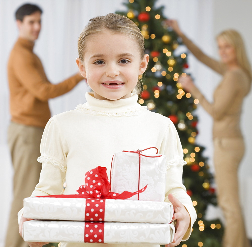Portrait of girl holding gifts on Christmas