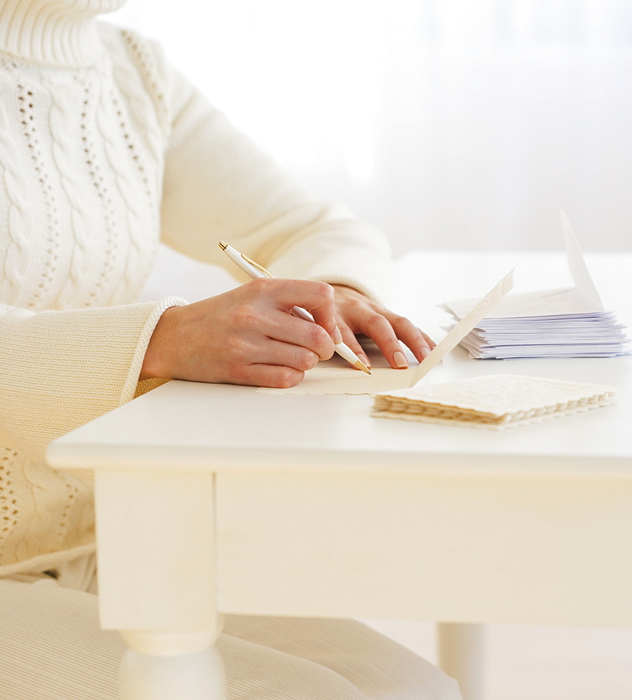 Woman writing cards