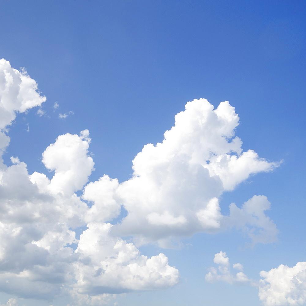 Cumulus clouds in blue sky