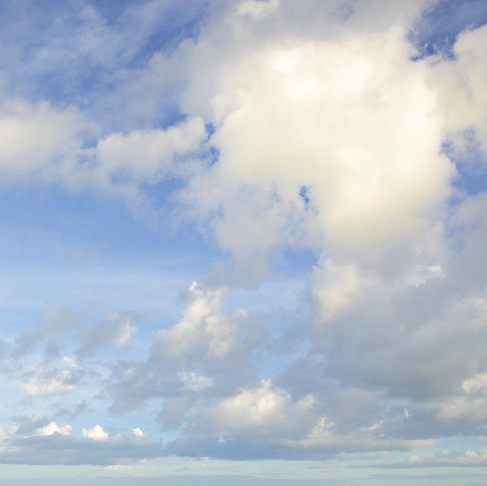 Cumulus clouds at sunset