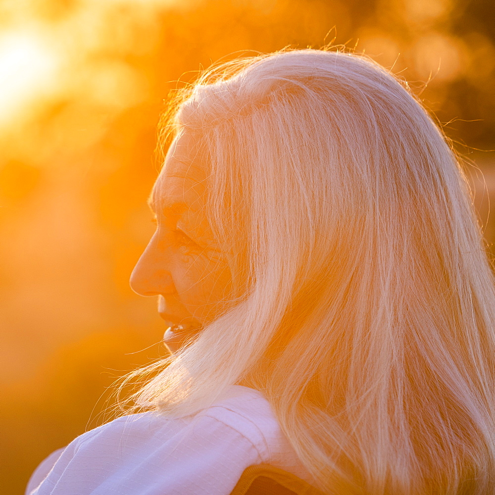 Portrait of mature woman at sunset