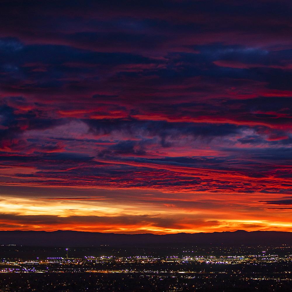 Cityscape under dramatic sky at sunset, Boise, Idaho, USA