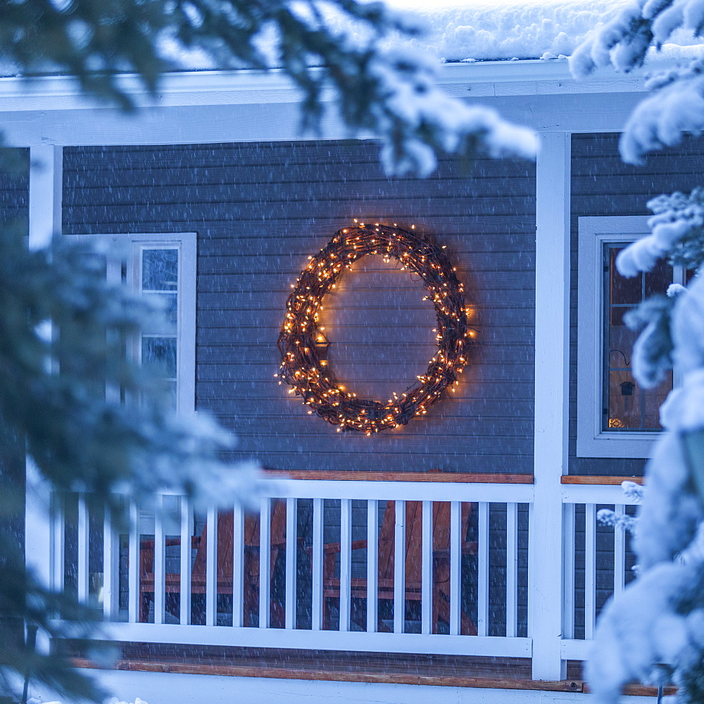 Illuminated Christmas wreath on house during winter - 1178-28582