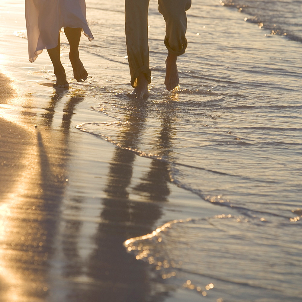 Couple strolling on a beach