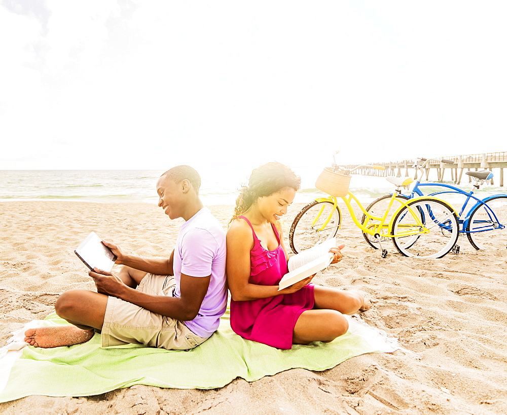 Young couple relaxing on beach, Jupiter, Florida