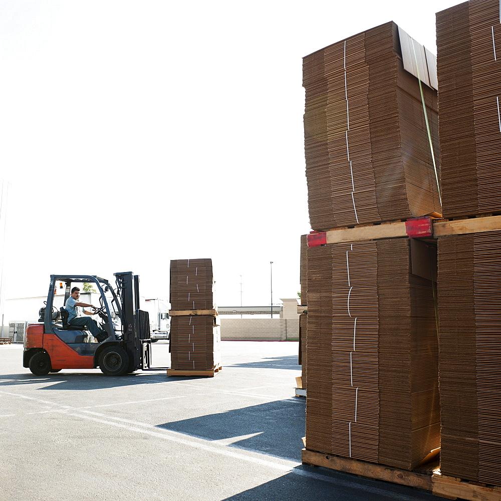 Forklift truck moving pallets