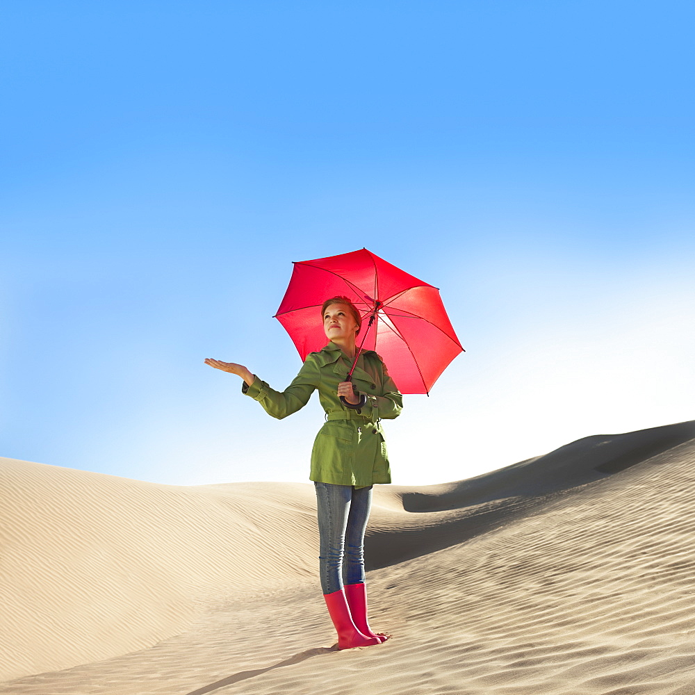 Woman waiting for rain in the desert
