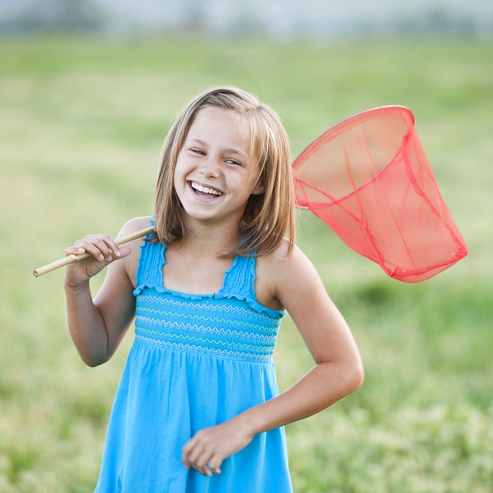 Young girl holding a butterfly net