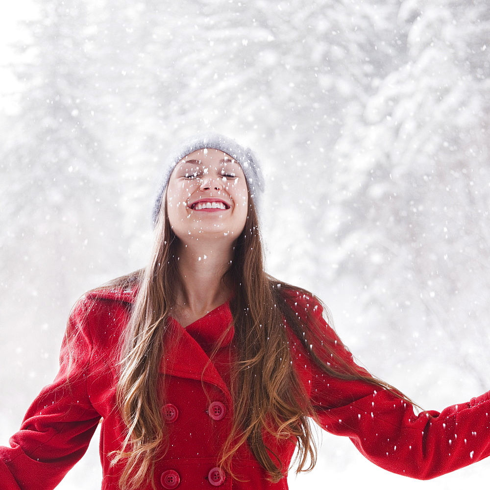 Happy woman outside on a snowy day