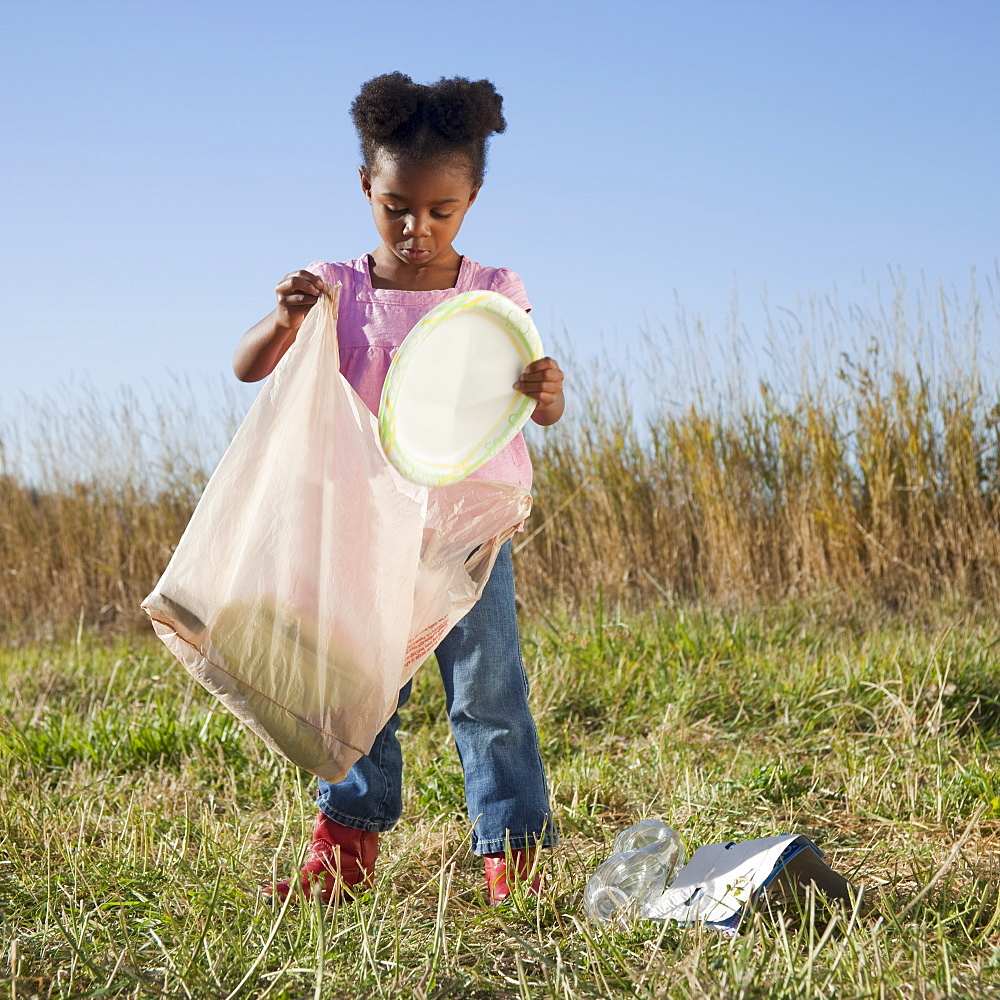 Young girl picking up litter - 1178-8634