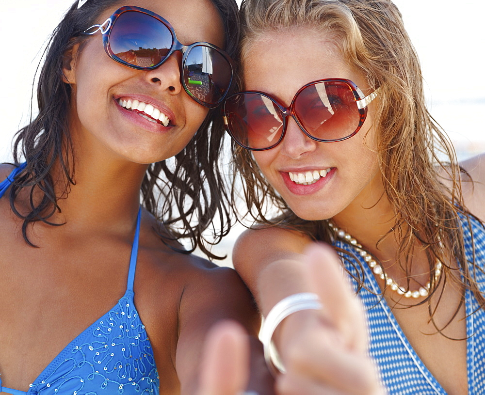 Portrait of young women posing on beach