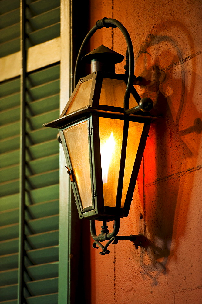 Lantern on wall of building in French Quarter of New Orleans