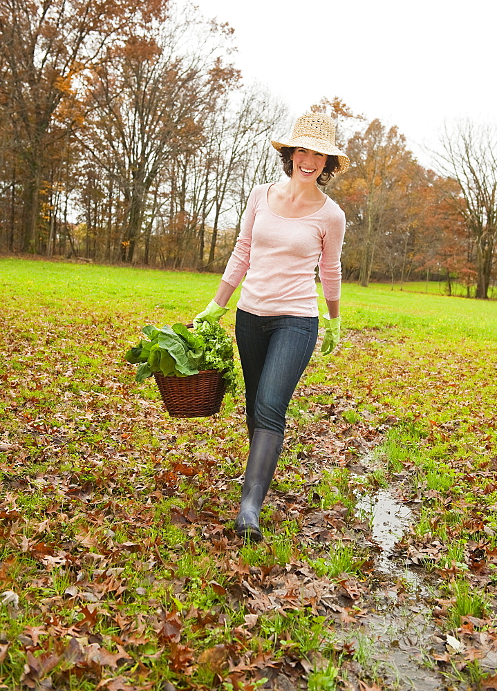 Woman walking with basket of vegetables