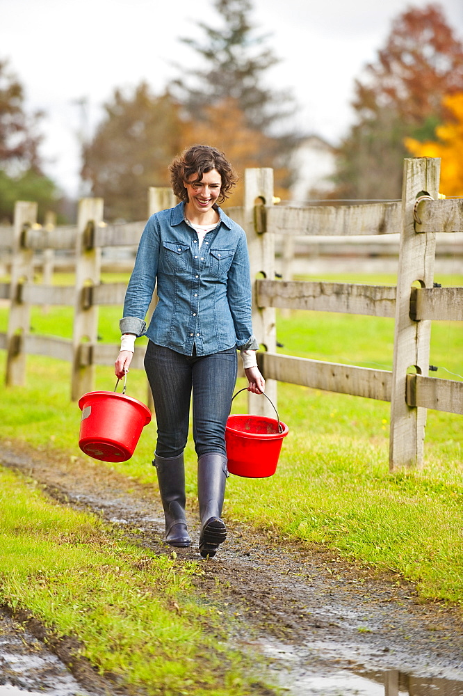 Woman carrying buckets