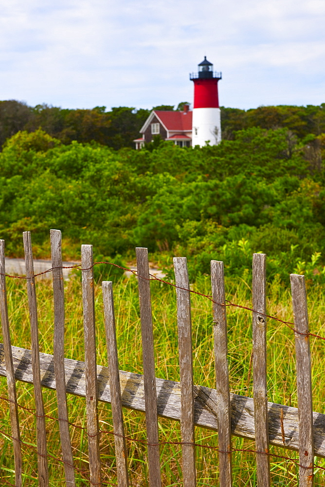 Fence in front of lighthouse