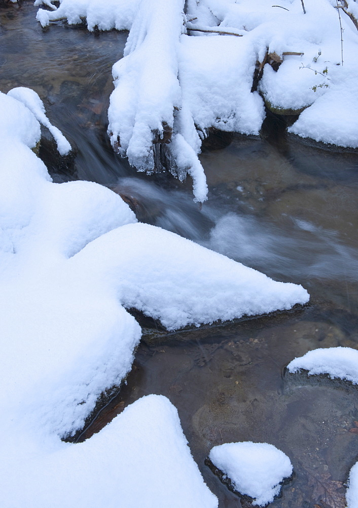 Snowy stream in winter