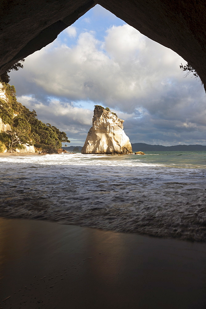 Moody sky over rock formation, New Zealand, Cathedral Cove