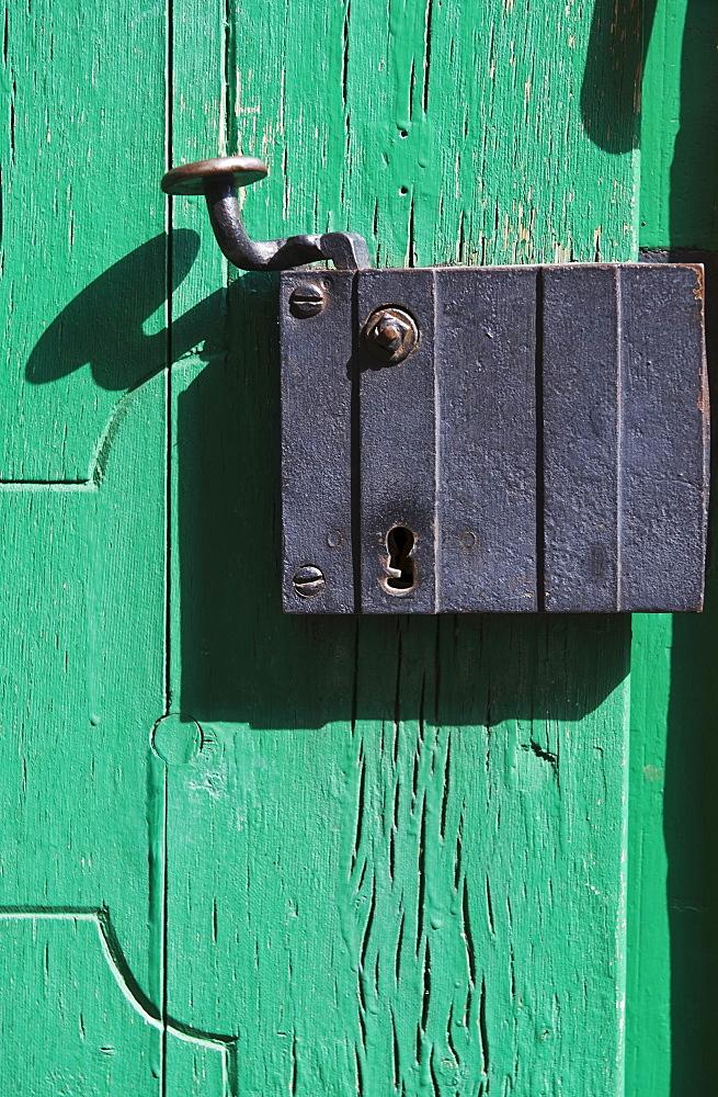 Close up of old door latch in Prague