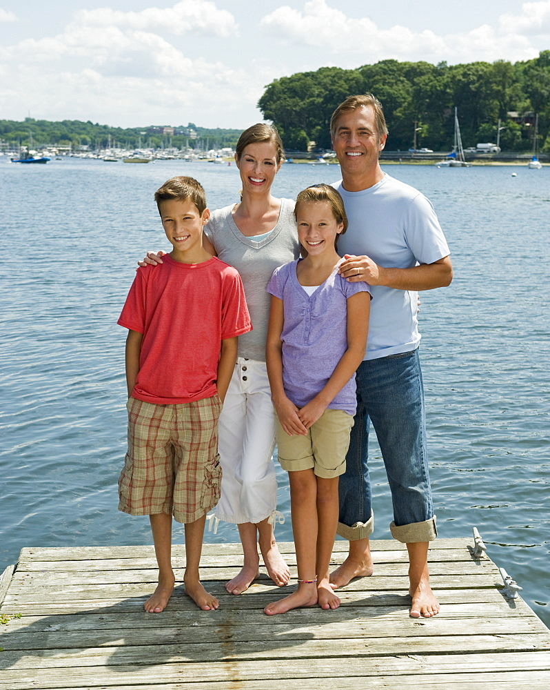Family posing together on dock