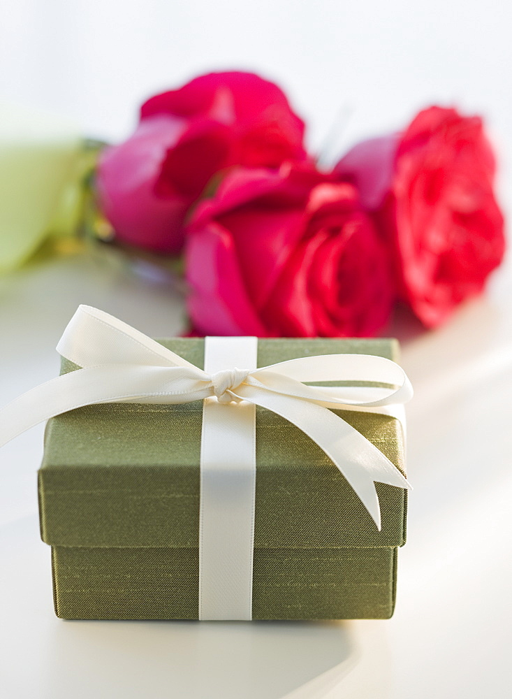 Close up of gift box and flowers